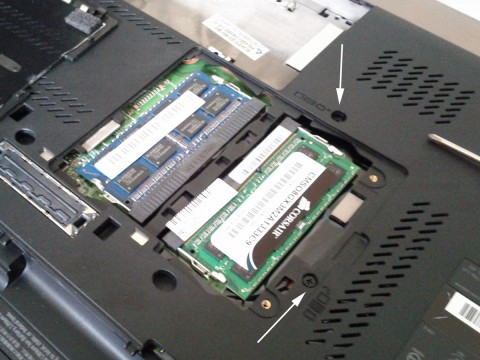 Bottom of Lenovo W520 with memory cover removed showing the two keyboard screws.