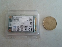 Intel 310 SSD compared to a coin